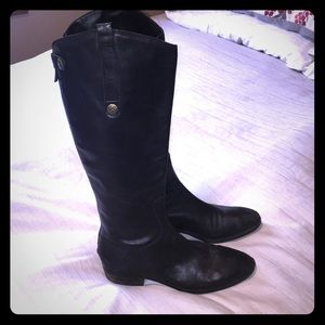 Tall black boots with small heel